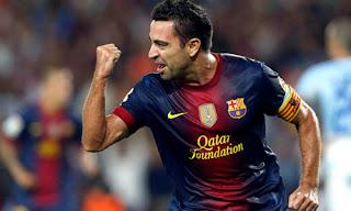 Xavi saat mencetak gol kegawang Granada