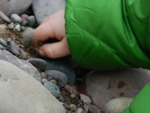 toddler playing in the dirt blackfoot river montana