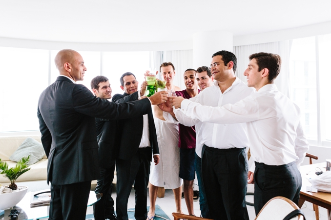 groom and groomsmen toasting before the wedding