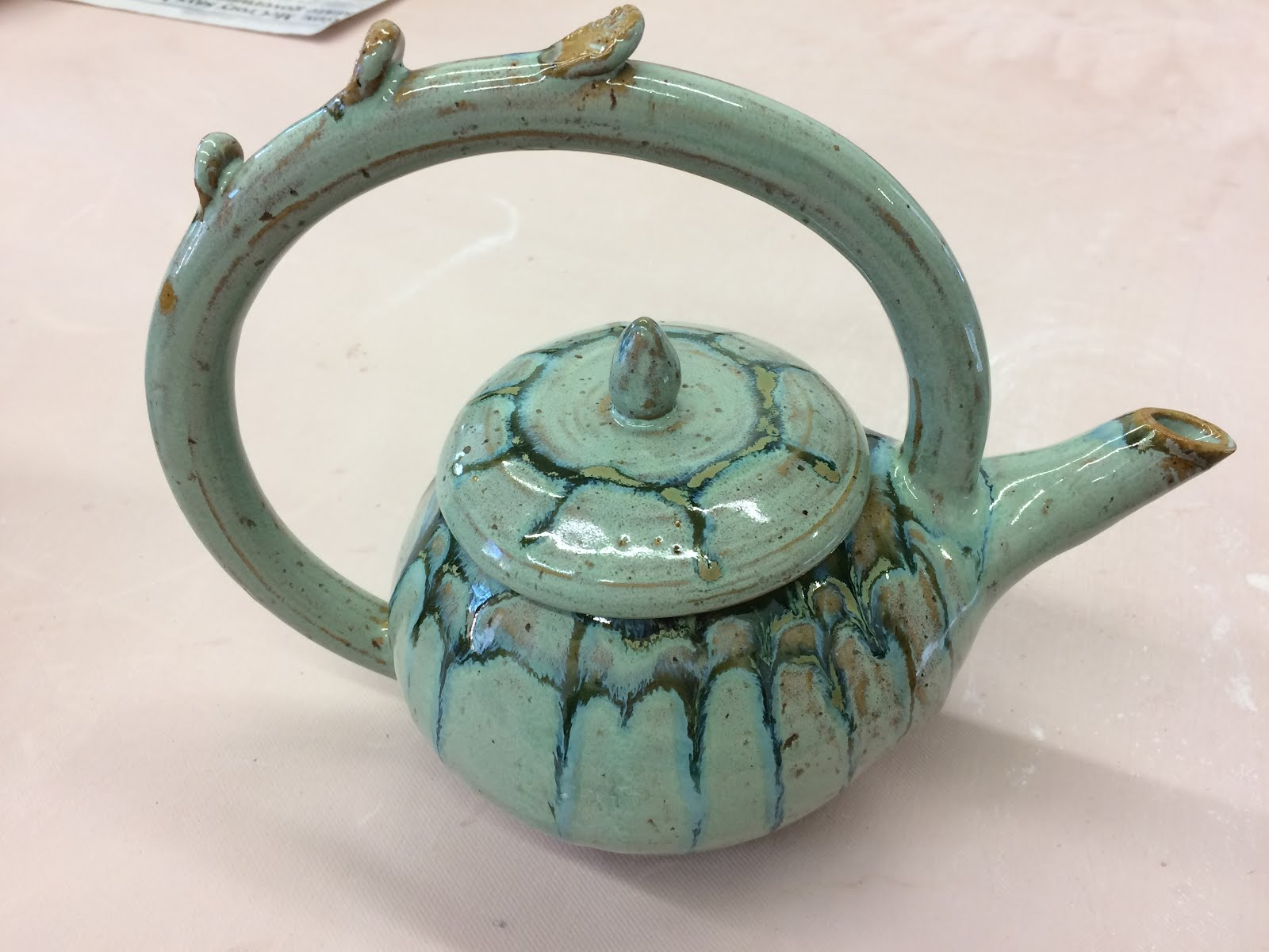 Teapot with Celtic Cross knobs, turquoise glaze, 12 inches tall by 14 inches wide