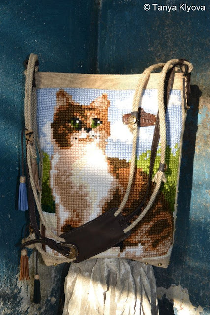 Cross Stitched Embroidered Cat on Handbag, mady by Tanya Klyova, a designer from Ukraine