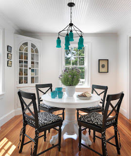 Lovely Blue Chandelier above the White Dining Room Tables For Small Spaces and Black Wooden Chairs around it