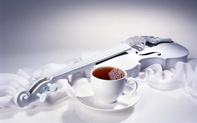 White violins with a cup of tea - Music Violins Collection