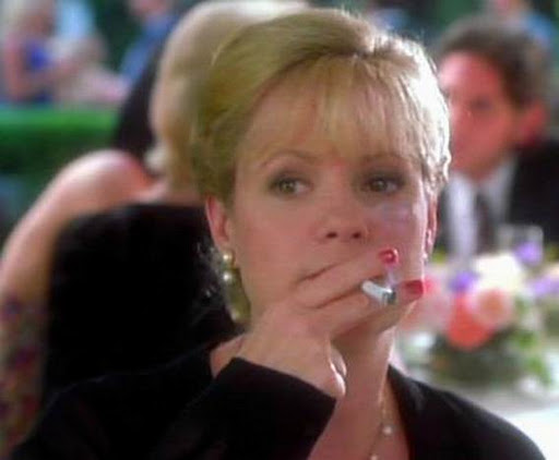Bonnie Hunt smoking a cigarette (or weed)