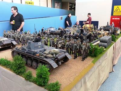 1/6 scale diorama of an army post on display at a scale model exhibition.