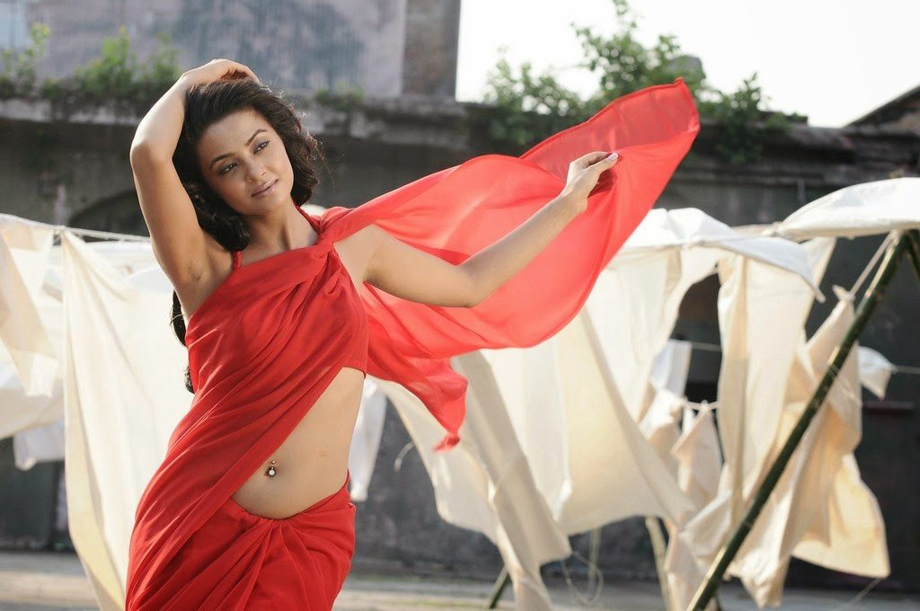 Actress Surveen Chawla in hot red saree
