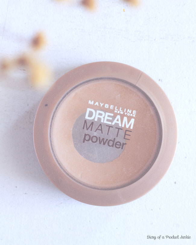 Maybelline Dream Matte Powder on a qhite wood plank