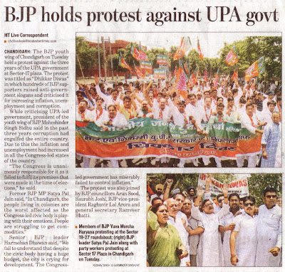 BJP leader Satya Pal Jain along with party workers protesting at Sector 17 Plaza in Chandigarh on Tuesday.