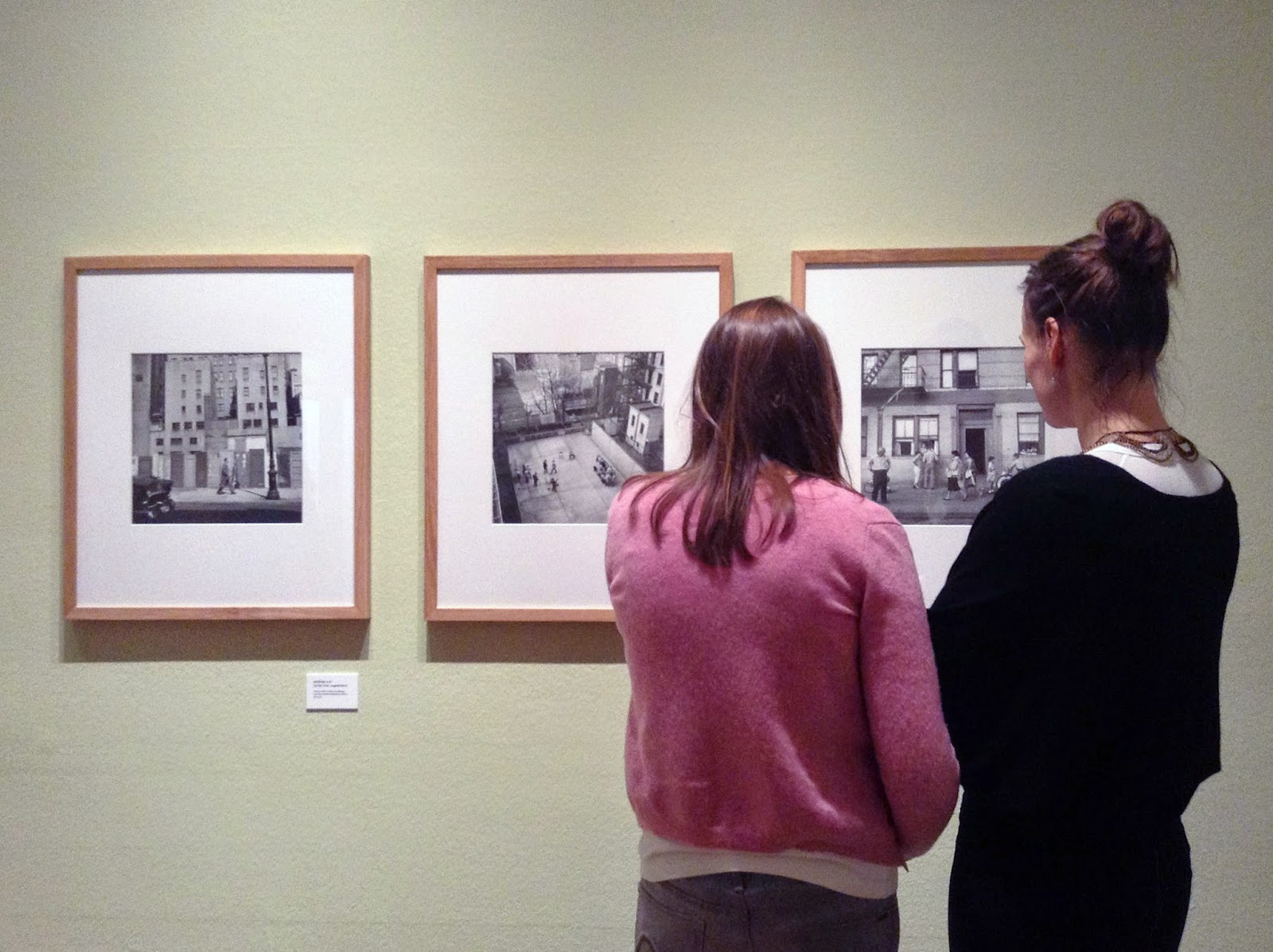 two women looking at photographs of Vivian Maier