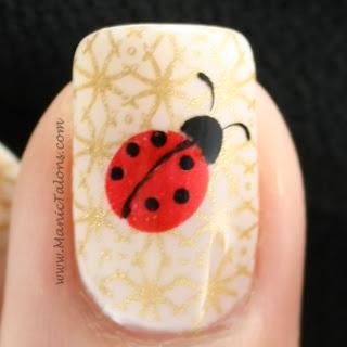gold and ladybug