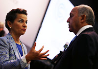The French Foreign Minister, Laurent Fabius, talks to Christiana Figueres, the executive secretary of the U.N. Framework Convention on Climate Change, in Bonn on Tuesday. (Photograph Credit: Oliver Berg/EPA/Landov) Click to Enlarge.