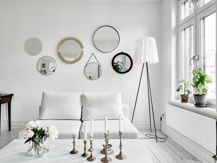 Deco apartamento de estilo escandinavo en color blanco for Espejos redondos salon