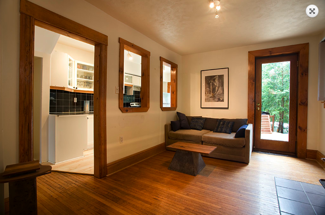 ... Kitchen and Living Room with its knotty pine and rustic oak wood trim