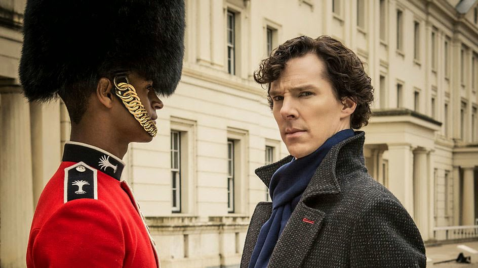 Benedict Cumberbatch as Sherlock Holmes with Alfie Enoch as Bainbridge, the bloody guardsman in BBC Sherlock Season 1 Episode 2 The Sign of Three