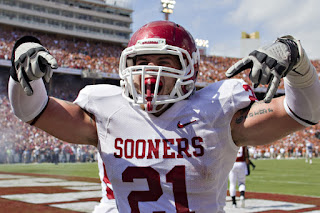 Tom Wort #21 of the Oklahoma Sooners celebrates after a touchdown against the Texas Longhorns at the Cotton Bowl on October 8, 2011 in Dallas, Texas. The Sooners defeated the Longhorns 55 to 17. (October 7, 2011 - Source: Wesley Hitt/Getty Images North America)