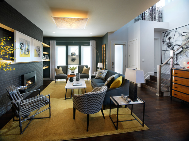 A Palette Of Pineapple, Charcoal Gray And Soft White Lends A Sophisticated,  Urban Sensibility To The Living Room, Illuminated By A Diffused Fabric  Light ...