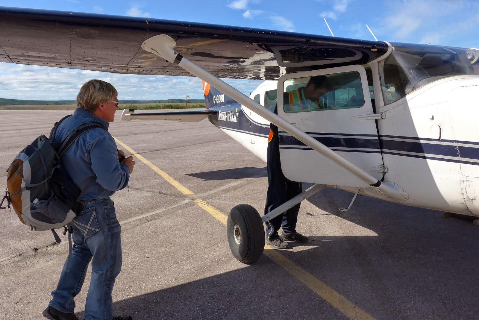 Anders boarding plane.