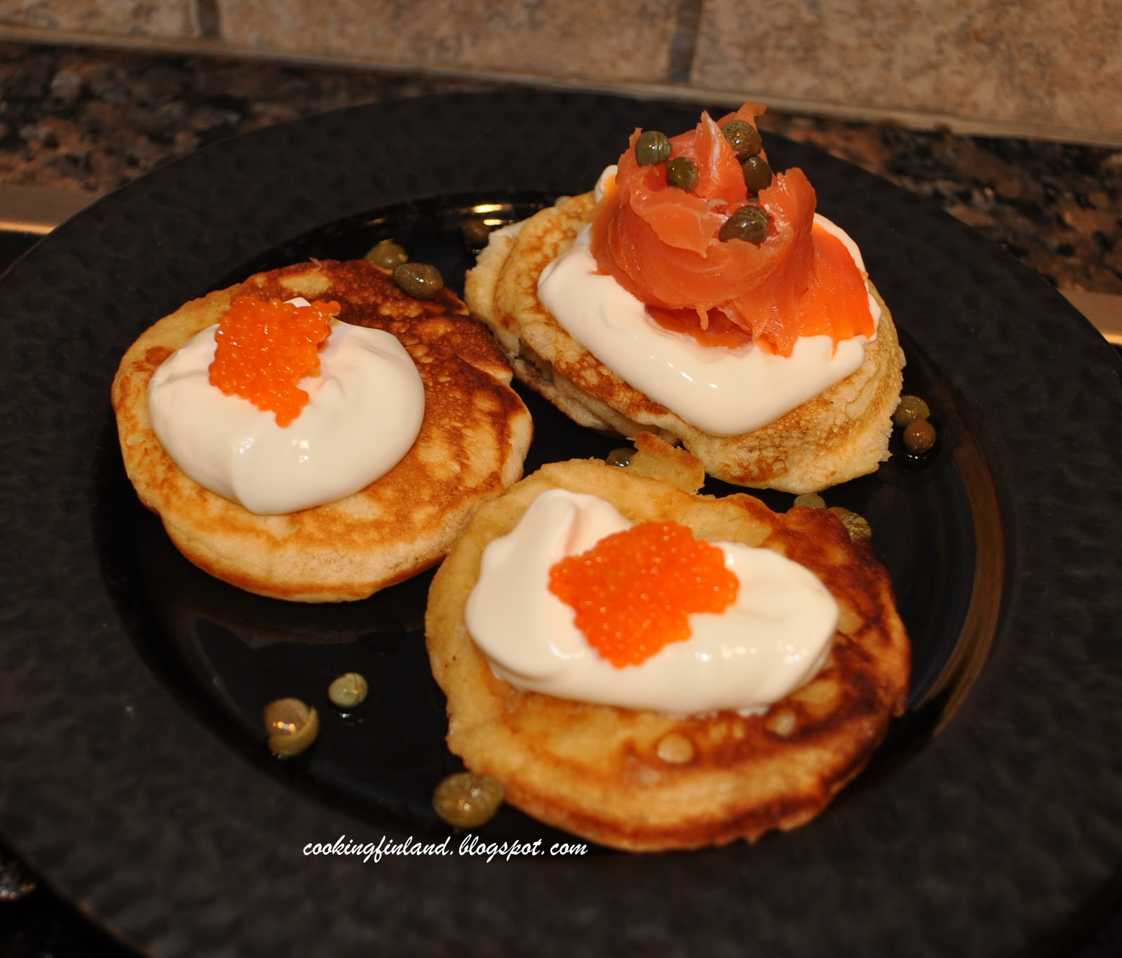 ... Finland: Blinis with sour cream, caviar and smoked salmon--blinit
