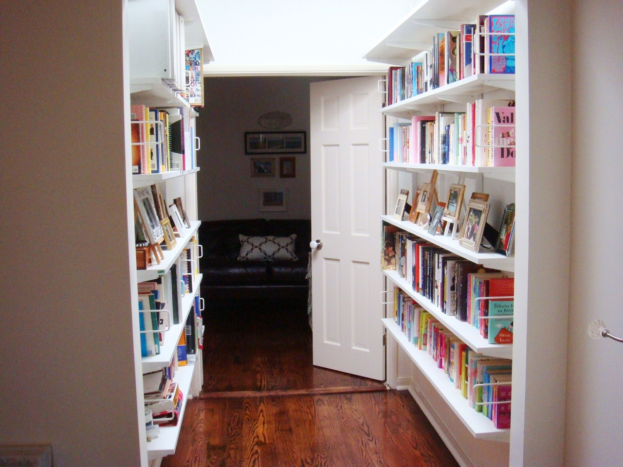 After Replacing The Honey Colored Open Shelving Bookshelves With White Ones To Brighten Space