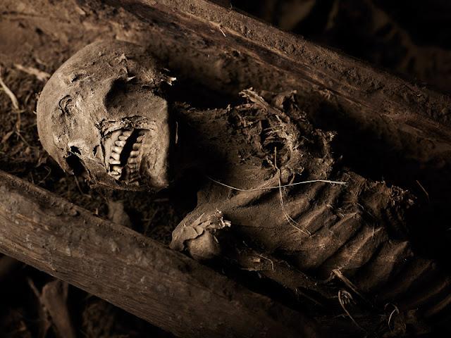 YEMREHANNA KRISTOS  A pilgrim's corpse rests at Yemrehanna Kristos, Lalibela Ethiopia.