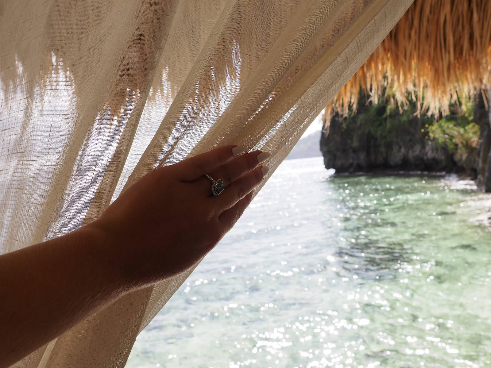 Hand opening curtain to stunning sea view
