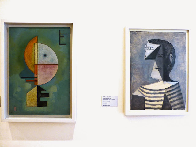 "V. Kandinsky ""Upward"" y P. Picasso ""Hang-length portrait of a man"""