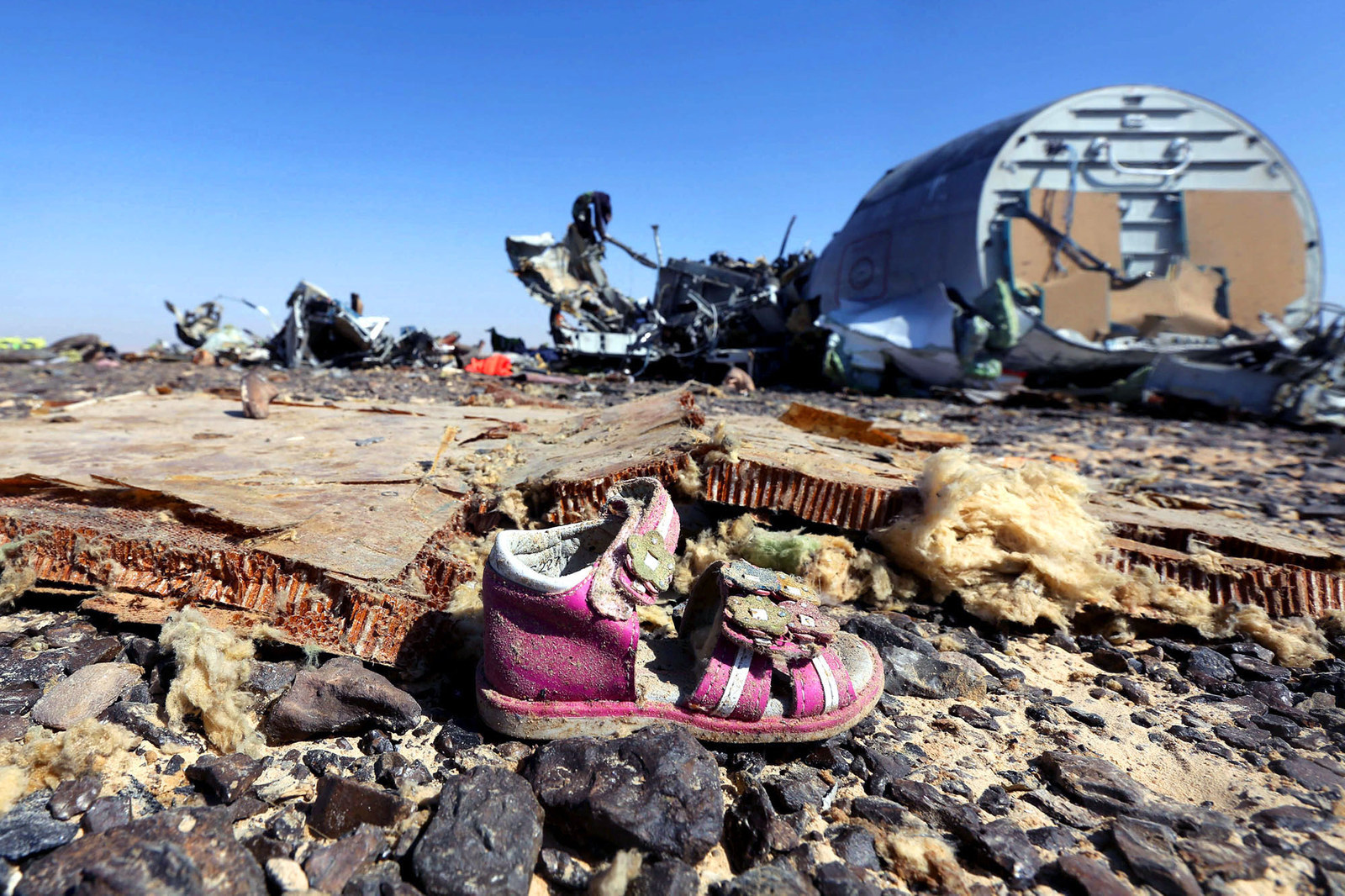 70 Of The Most Touching Photos Taken In 2015 - 70 Of The Most Touching Photos Taken In 2015 - A child's shoe lays by the wreckage of a Russian airliner which crashed in Egypt, killing all 224 on board. Russian and Western governments believe it was brought do