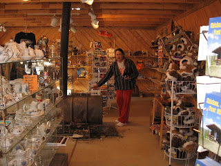 The Chicken Mercantile offering many unusual gift and souvenir items. It is heated by a wood burning barrel stove.