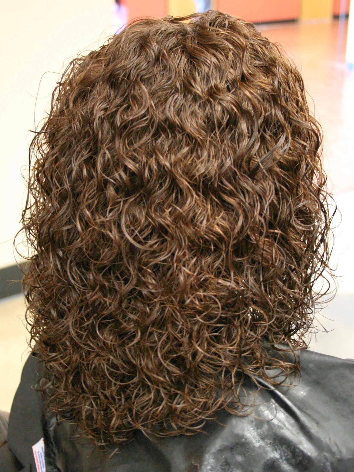 perm that took stronger on the ends due to the hair being more porous