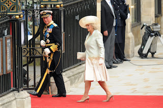 Camilla, the Duchess of Cornwall, (R), and Britain's Prince Charles (L) arrive at the West Door of Westminster Abbey