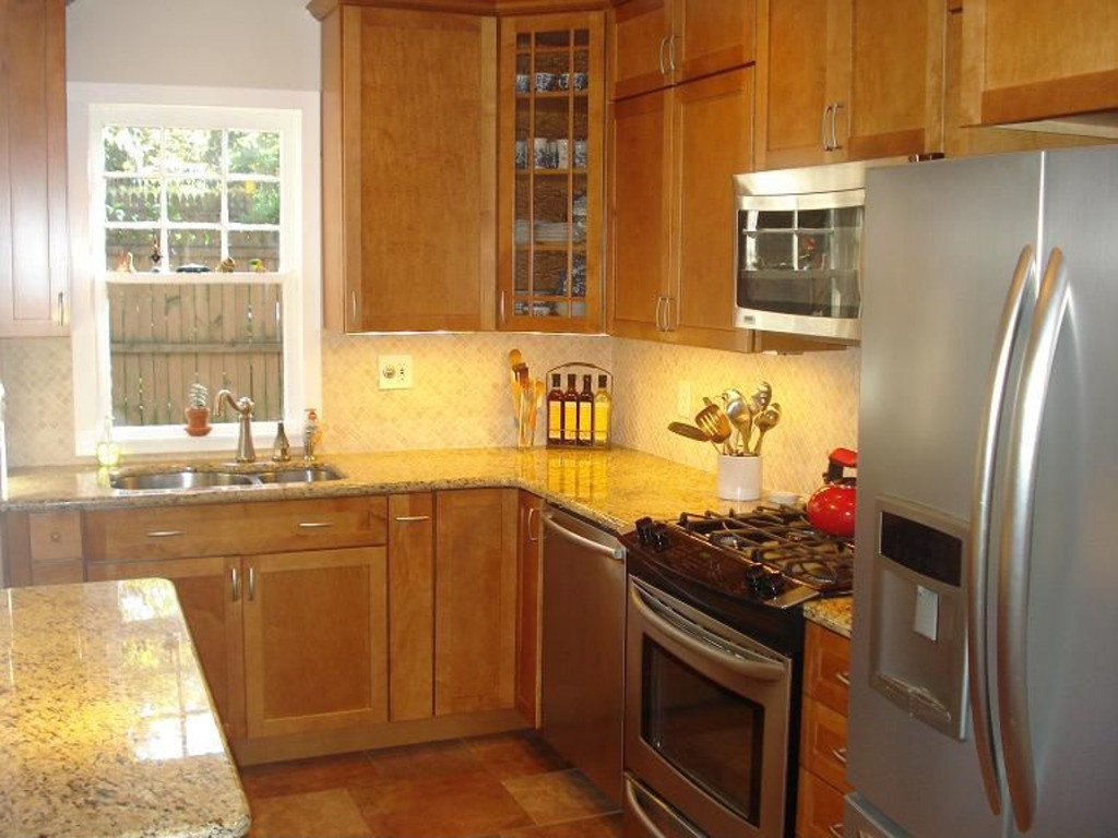 High End Renovated Kitchen With Granite Counters, Custom Tile Backsplash, Under  Cabinet Lighting, And High End Stainless Appliances With A Gas Stove/oven.