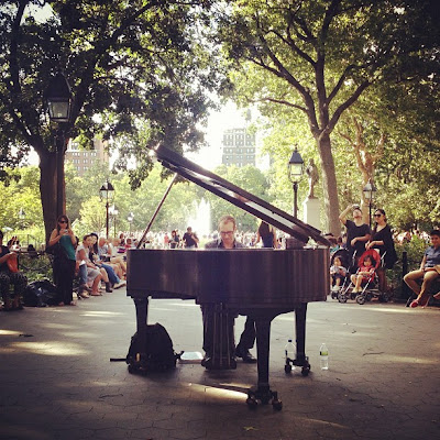 Live music piano in Washington Square Park in New York City in summer