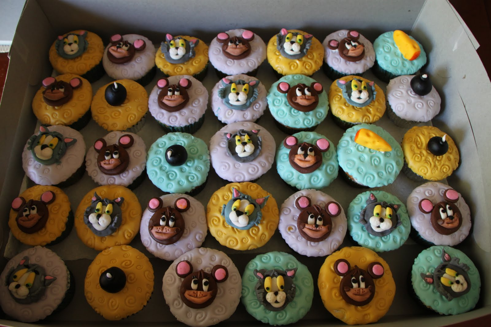 DHANYAS DELIGHTS Tom and Jerry Cake and Cupcake