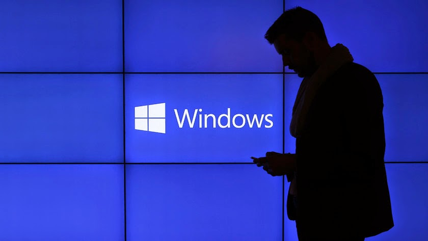 A Windows display at a Microsoft Corp. news conference ahead of the Mobile World Congress in Barcelona, Spain, on Feb. 23, 2014. (Credit: Simon Dawson/Bloomberg) Click to enlarge.
