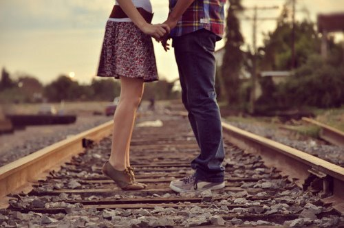 couples on train tracks