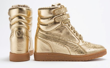 0fa0995c3b16 The Luxe Sky Wedge features an upper constructed of buttery gold foiled  leather