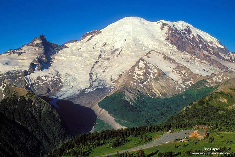 Mount Rainier towers over Yakima Park at Sunrise in Mount Rainier National Park, Washington.