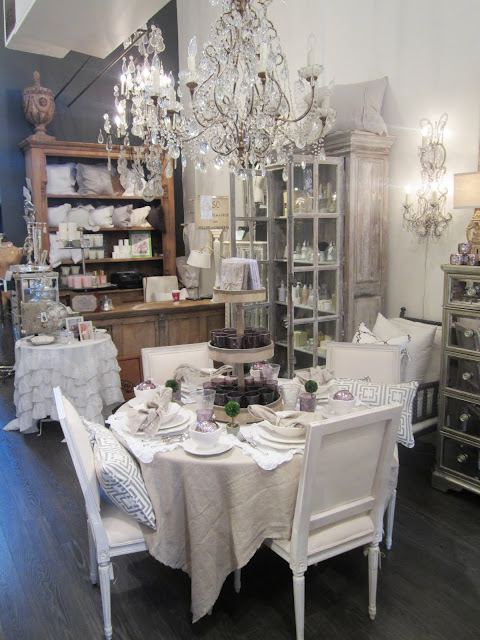 Pom Pom Interiors' store with a table scene complete with Nbaynadamas pillows