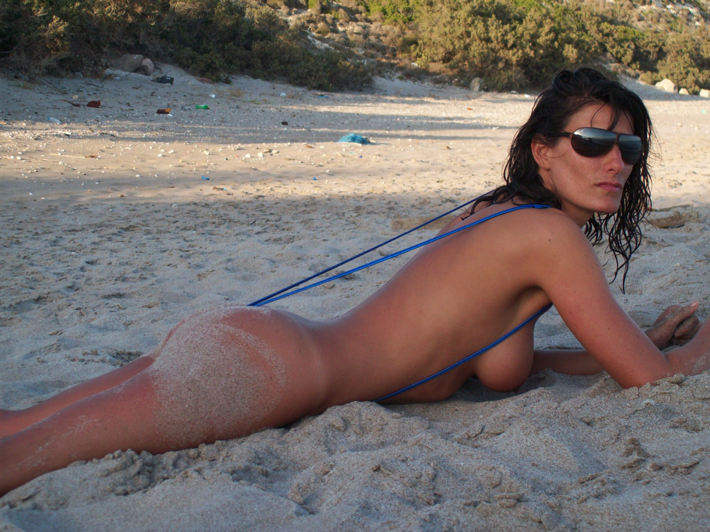 Here are two more shots of Emma in her metallic blue sling bikini on the ...