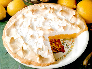 Classic meringue pie with an orange and lemon custard filling over a pastry base served topped with a baked egg white meringue