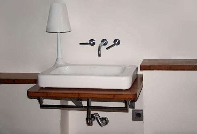 Encimeras Baño Wengue:Fabricación y montaje de encimera de baño a medida realizada con