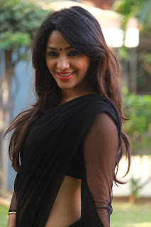 Actress Samruthika  Picture Gallery in Black Saree at Aayirathil Iruvar Movie Press Meet CelebsNext 1.JPG
