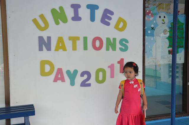 Kecil in front of the UN Day sign