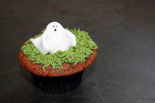 Red Velvet cupcake topped with buttercream grass and a fondant ghost