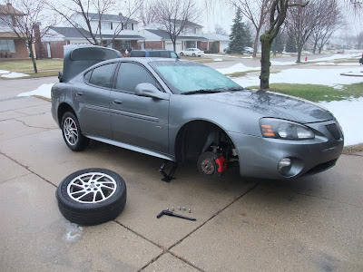 bent tire rim, pontiac, tire change
