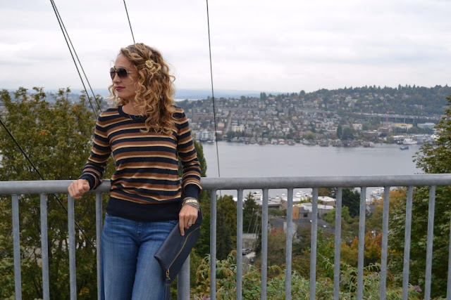 striped sweater, curly hair, aviators