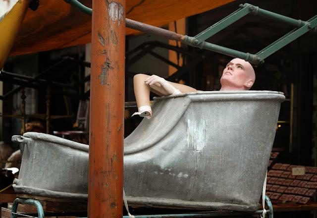 Saint Ouen Flea Market street art installation tin bath mannequin