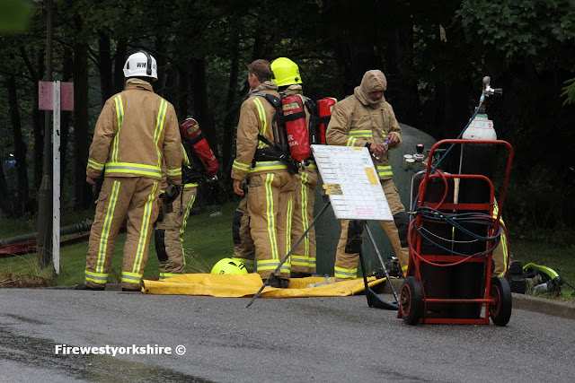Breathing apparatus crews at the rear of the factory