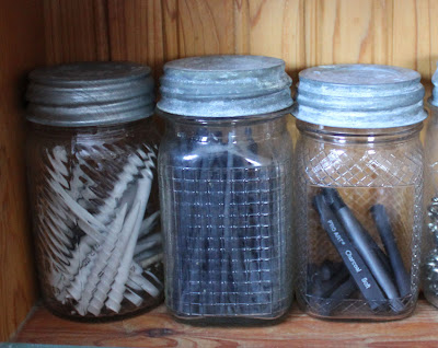 artist charcoal in glass jars