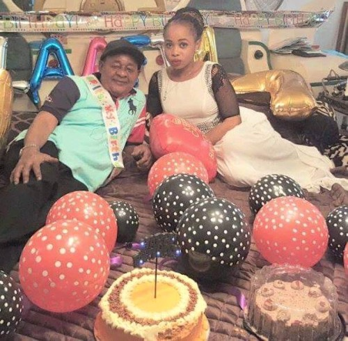 Alaafin of Oyo celebrates his 77th birthday with his youngest wife and a sash and baloons